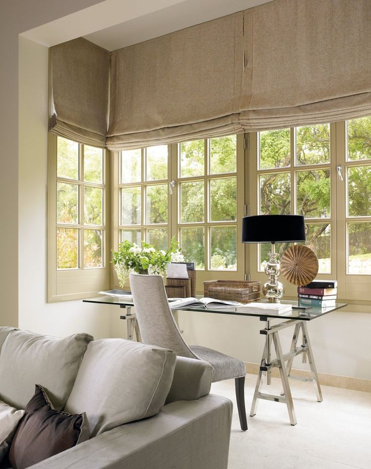 Roman blinds in a square bay,using a heavy linen for a natural look.