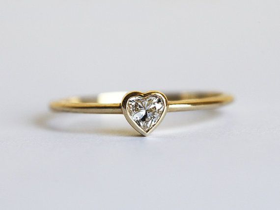 Pretty little heart diamond ring. This ring is 18K gold but can be made in white or rose gold too. Perfect for layering. Nice to wear every day, or as