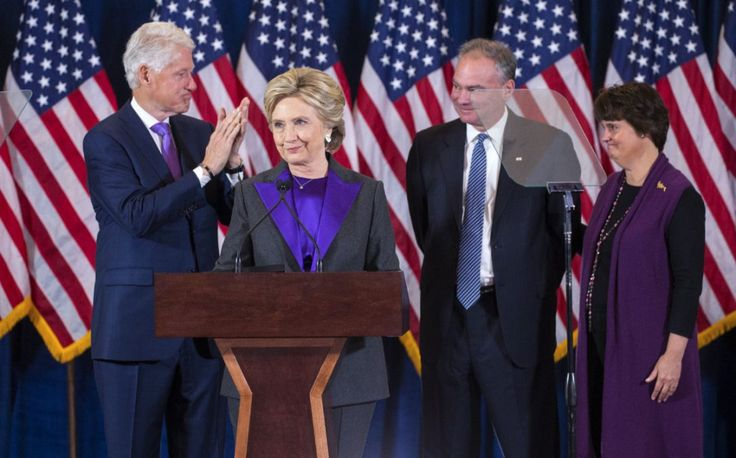 Hillary Clinton greets the crowd for her concession speech at a New York hotel on Wednesday, accompanied by former president Bill Clinton, Sen. Tim Kaine and Anne Holton.