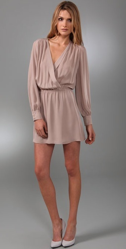 I have a dress almost identical to this in dark red.  I love the cut, it's ideal for creating the illusion of fuller breasts and more curves in a super-skinny-not-in-an-attractive-way person like me. <3  The simplicity of the dress works well with my tendency to pile on the jewelry too, lol.