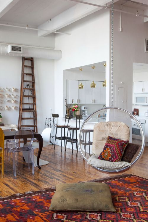 "Sneak Peek: An Eclectic Philadelphia Loft. ""The bubble chair is from Plushpod and the postal sacks on the cushions are from the Paris flea market."" #sneakpeek"
