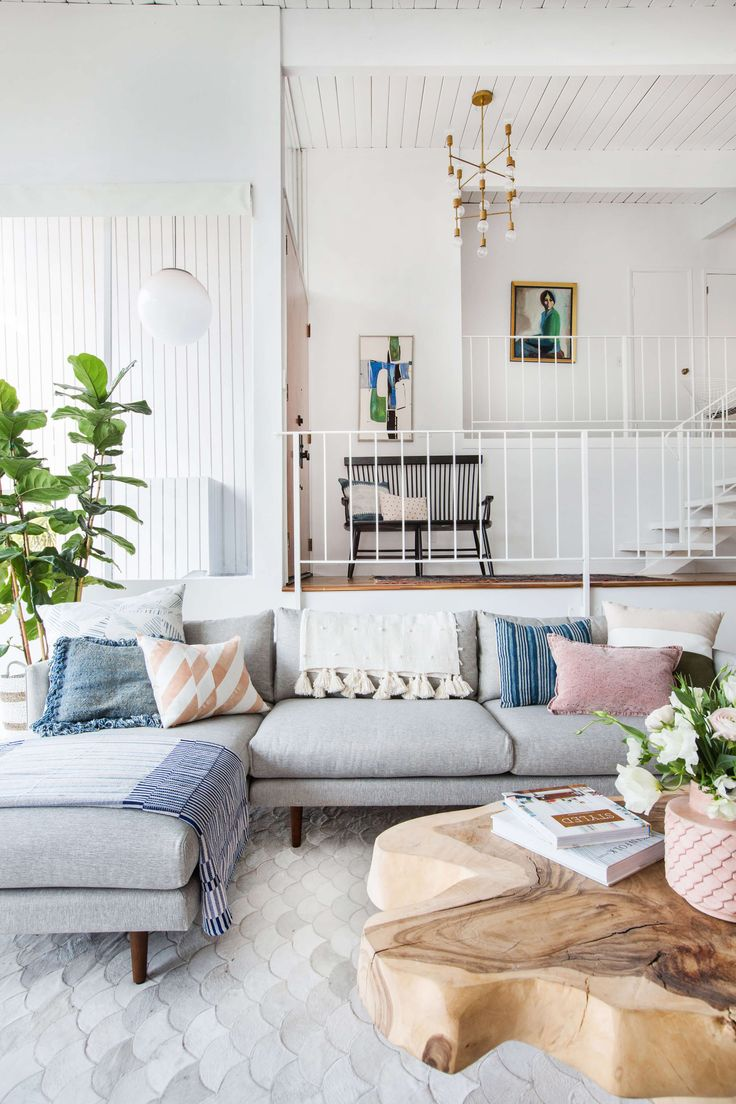 Emily henderson living room staged to sell boho mid century eclectic blue white styled couch sectional