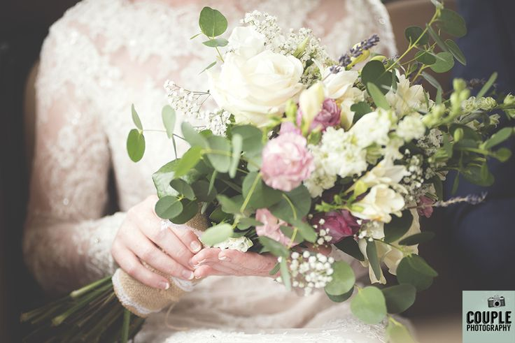 The bride's gorgeous natural bouquet of flowers and detail of her vintage style lace dress. Weddings at Tulfarris Hotel by Couple Photography.