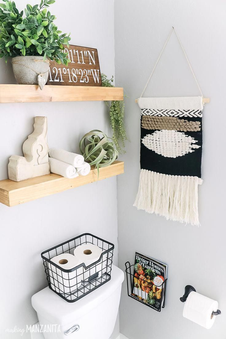 Love how she decorated these shelves above the toilet in this boho farmhouse bat…   – bathroom shelf