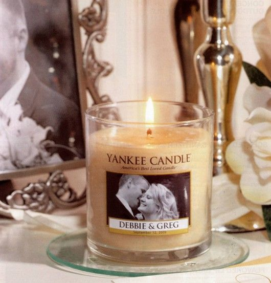 Yankee Candle makes customized candles for weddings! all you have to do is call and make an order... love it