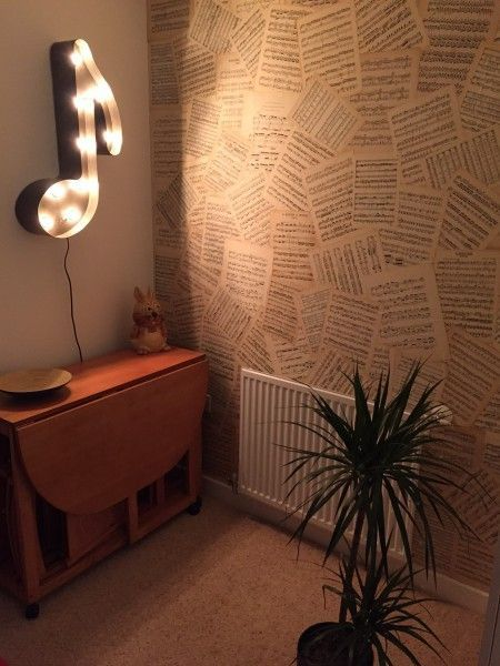 The Broadway Note Wall Lamp sits perfectly next to Matthews musical wallpaper   made.com/unboxed