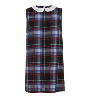 This tartan check tunic dress is ideal for the daytime and evening looks whilst being on trend for the whole winter season. Easily dressed up or down, this one's a wardrobe essential. #nlfashion #dress #dresses #tartan #print