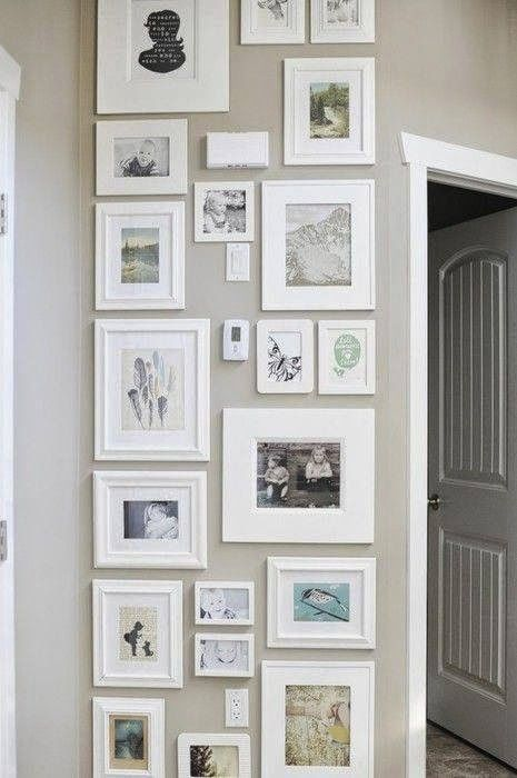 Thermostats and smoke detectors have a way of being in the worst spots when it comes time to hang framed pieces. That didn't stop this homeowner from filling the wall with framed art and photos. Look at how those fixtures blend right in.
