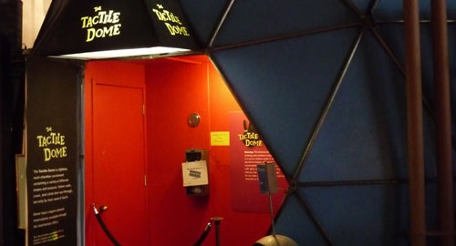 Discover the unseen world of the Tactile Dome— An interactive excursion through total darkness, where your sense of touch becomes your only guide! San Francisco Exploratorium