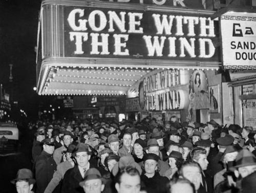 Waiting to see the movie 'Gone With The Wind'. Ticket prices in 1939 were five cents for the matinee and ten cents for an evening performance. From December 1939 to July 1940, the film played only advance-ticket road show engagements at a limited number of theaters at prices upwards of $1—more than double the price of a regular first-run feature.