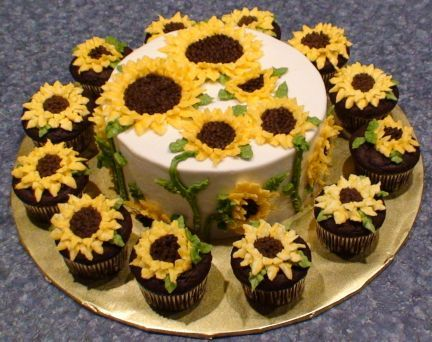 Sunflowers Birthday Cake - For my grandma's birthday. She loves sunflowers, and it was for a picnic - I knew it would be perfect. Got the idea from Peggy's Baking Corner (http://whatscookingamerica.net/PegW/SunFlower/SunflowerCupcakes.htm). WASC cake - Darn good chocolate cake cupcakes.