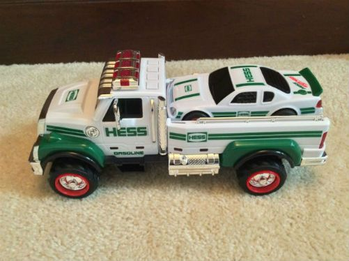 Vintage 2011 Hess Toy Truck and Race Car. 2011 introduces another first for Hess toy innovation and that is the first four-wheel independent suspension on a Hess toy. This enhancement lets the truck sway and bounce with wheels firmly on the ground. And there the great chrome detail too. Two toys in one get you a truck and race car. This stock-car racer came with powerful lights and sounds. Press the gas cap to find a four-speed engine sequence. Wait pull out the hidden ramp at the rear of…
