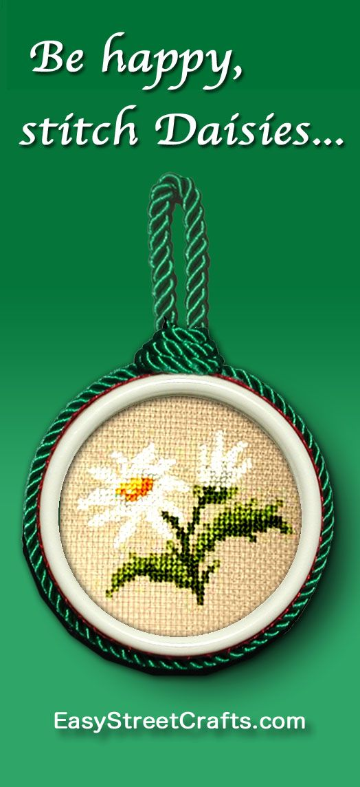 Cross-stitched Daisy is framed in a double-sided circle frame. Design is from alitadesigns.com