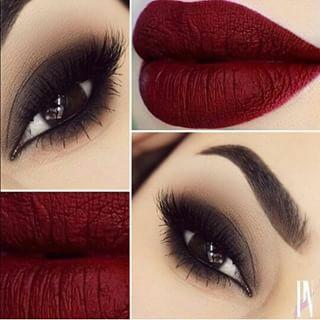 Dark smokey eyes and dark wine colored lips.