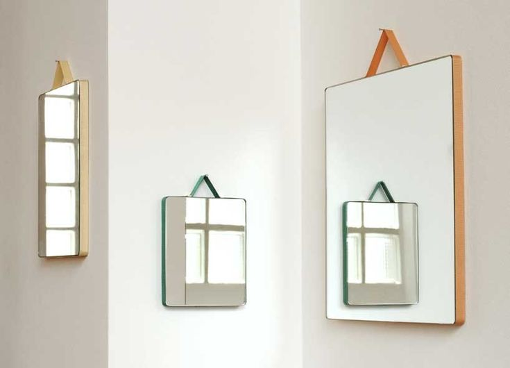 ruban mirrors for hay by inga sempé suspended by embedded ribbon