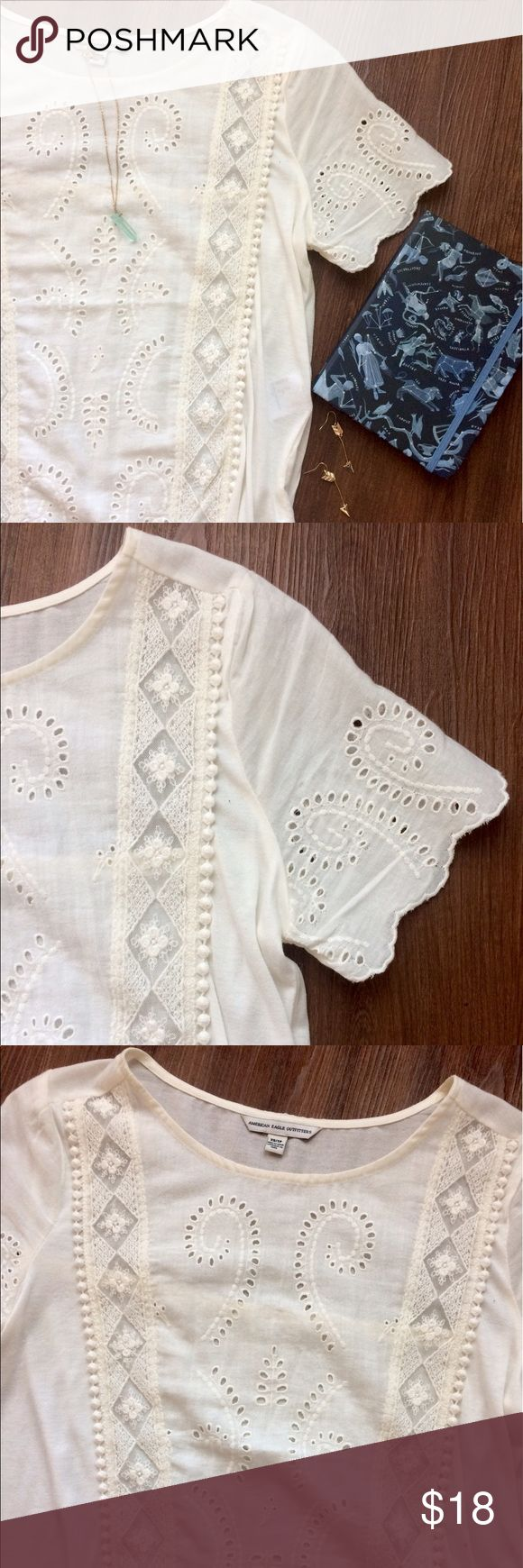 Bohemian White Cutout Shirt Bohemian White Cutout Shirt. Has floral lace paneling along the length and scalloped detailing on the sleeves. NEVER WORN, NWOT. Please make all offers through offer button! NO TRADES!! American Eagle Outfitters Tops