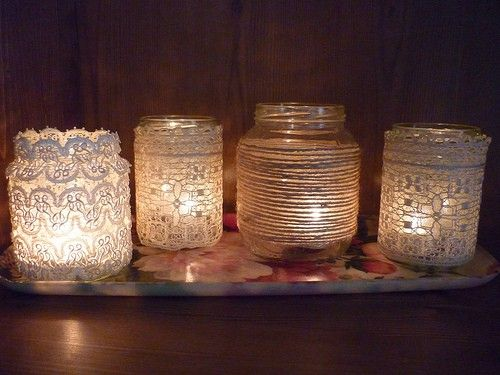 This is a DIY project that is fun and inexpensive. Pick your favorite lace pattern and twine, then glue them to jars with clear crafter's glue. Add a tea candle and you have created a warm lighting for your reception!