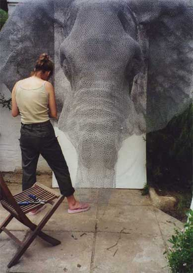 Kendra Haste working on her Elephant sculpture, constructed from wire mesh
