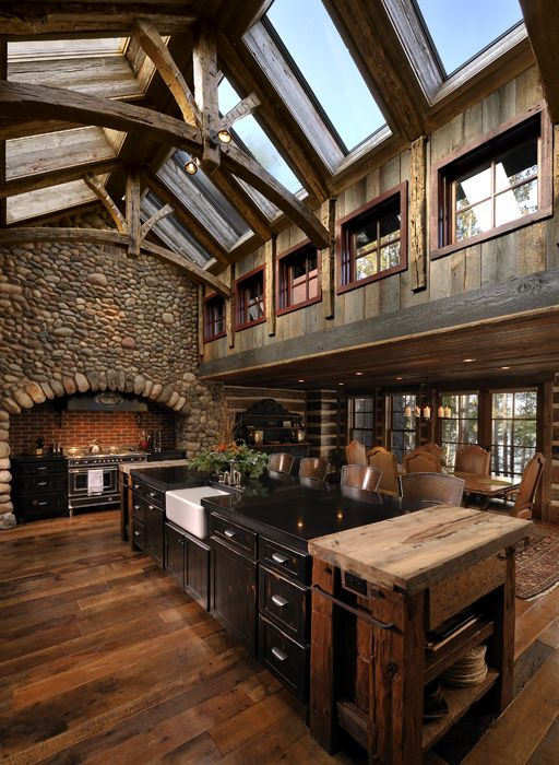 Reclaimed Wood Floors and natural lighting.  Love this!