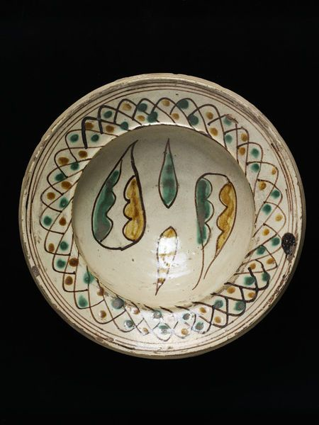 1230-1250 (made); Bowl; Italy (south; possibly, made), Sicily, Italy (possibly, made); Unknown (production); Tin-glazed earthenware, painted with copper, manganese and iron oxides; Museum number: 15-1871