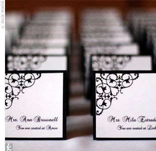 The square, tented escort cards were black and white with the wedding's signature black scroll design -- just like the invitations and programs.