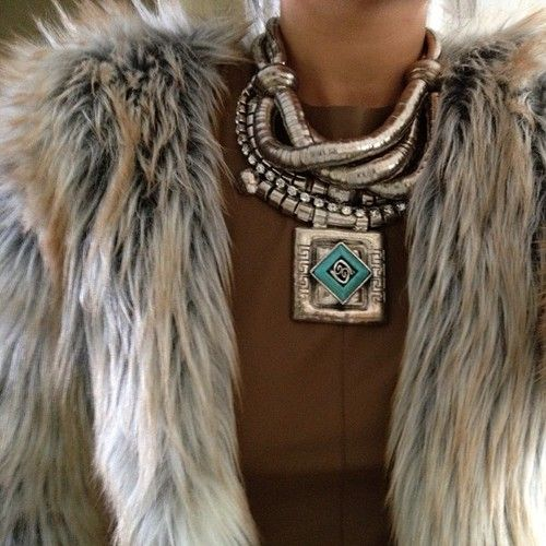 Not the traditional turquoise/silver look but it's great! The fur, the neutral background of her dress with the reflective silver. Just have to stare.