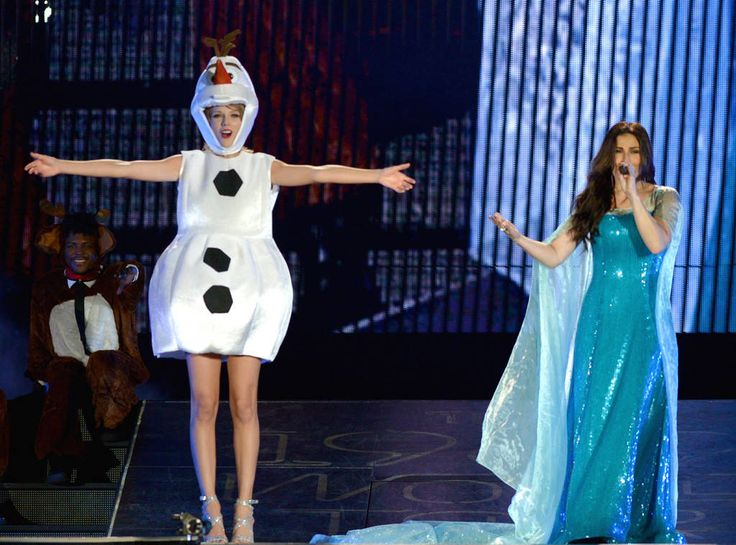 "Idina Menzel from Taylor Swift's Celeb Concert Cameos  The singer sang ""Let It Go"" with the Frozen star at her concert in Tampa, Florida, on Halloween...in costume!"