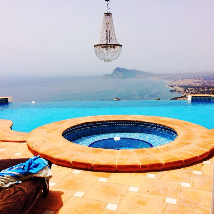 Large crystal chandelier for private pool party to make the sea view even more special.