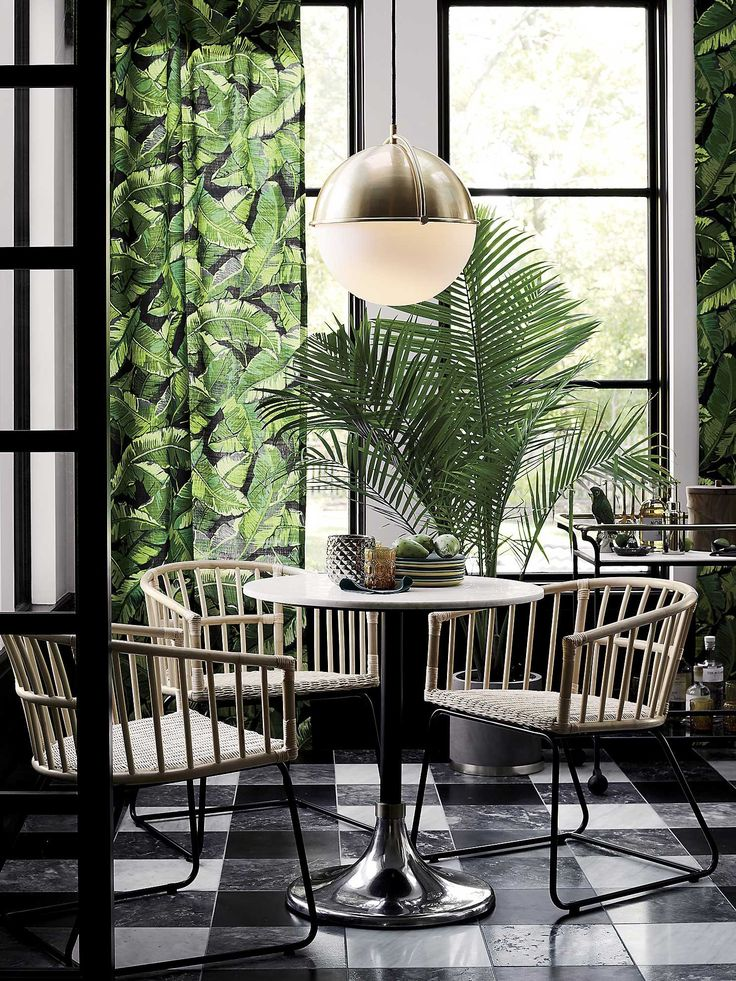 Tropical leaf print curtains in modern green dining room
