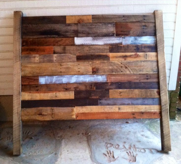 A headboard made from reclaimed pallet wood