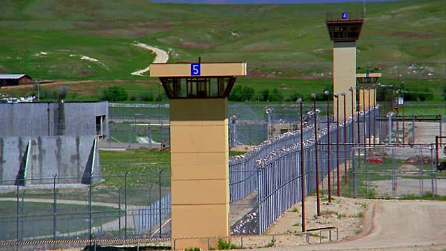 medium-shot-prison-guard-towers-video-id700-65 (640×360)