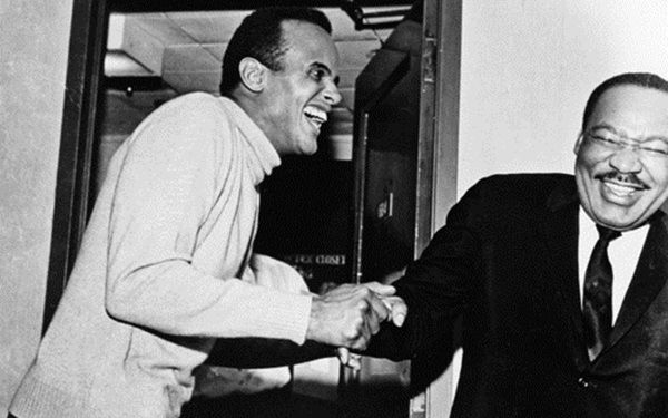 A Moment of Laughter: Civil Rights figures Harry Belafonte and Martin Luther King Jr. share a laugh.