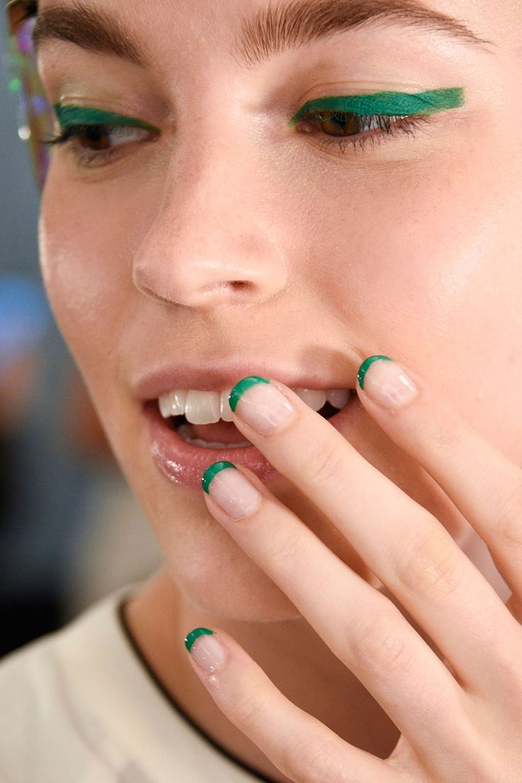 Green french tip nails + eyeliner. Monique Lhuillier. Photo: Imaxtree http://www.harpersbazaar.com/beauty/nails/g6493/nail-trends-spring-2016/?slide=3