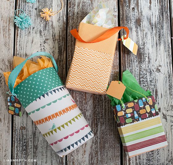 MAKE A CUSTOM GIFT BAG OUT OF SCRAPBOOK PAPER ... Fun!  And you could tweak the sizing as needed.