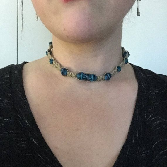 Handmade necklace features hemp woven into square knots with patterned turquoise beads. Closure is knot-through-loop.