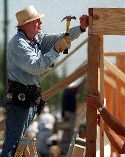 Jimmy Carter, building a Habitat for Humanity house - he walks the walk;  not just preaching the talk.