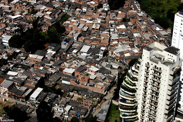 Paraisopolis (left), a slum consisting of some 60,000 residents, located right up against lavish pool-equipped apartments (right) in the Morumbi neighborhood of Sao Paulo, South America