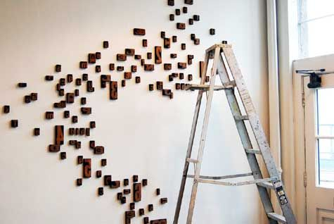 DIY Letterpress Block Wallhanging by designsponge: Made from blocks found at a flea market. #DIY #Letterpress_Wallhanging #designsponge