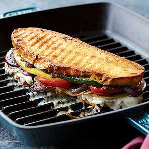 This vegetarian hot sandwich packs in savory eggplant and sweet bell peppers along with zucchini and red onions, all grilled to caramelize the sugars and create intense flavors.