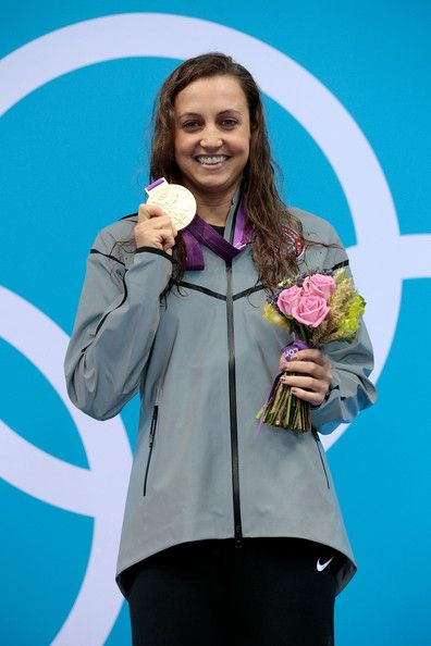 Gold medalist Rebecca Soni of the United States poses on the podium during the medal ceremony for the Women's 200m Breaststroke Final on Day 6 of the London 2012 Olympic Games at the Aquatics Centre on August 2, 2012 in London, England. Soni set a new world record time of 2:19.59 for the event.