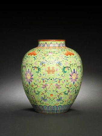 A rare famille rose lime-green-ground vase. Iron-red Jiaqing seal mark and of the period.