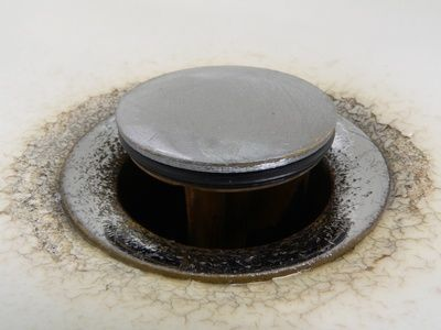 How to Get a Drain Plug Out of a Bathroom Sink