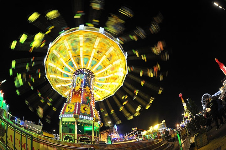 Munich, Germany: An illuminated carousel spins during the 178th Oktoberfest