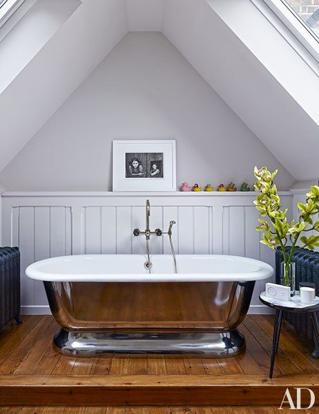 An Henri Cartier-Bresson photograph overlooks the master bath's Water Monopoly tub.