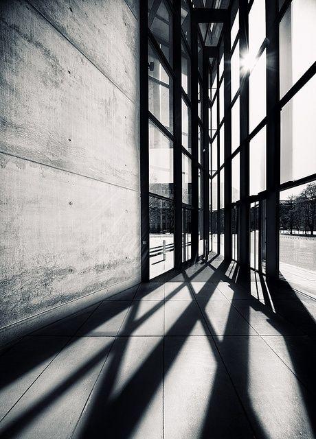 Concrete, sunlight, glass, steel, corner.