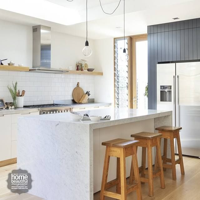 High appeal... beautiful grey panelling, marble bench top, timber shelving & pendant lights. #kitchendesign @homebeautiful