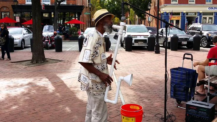 Man playing saxophone made from PVC pipe