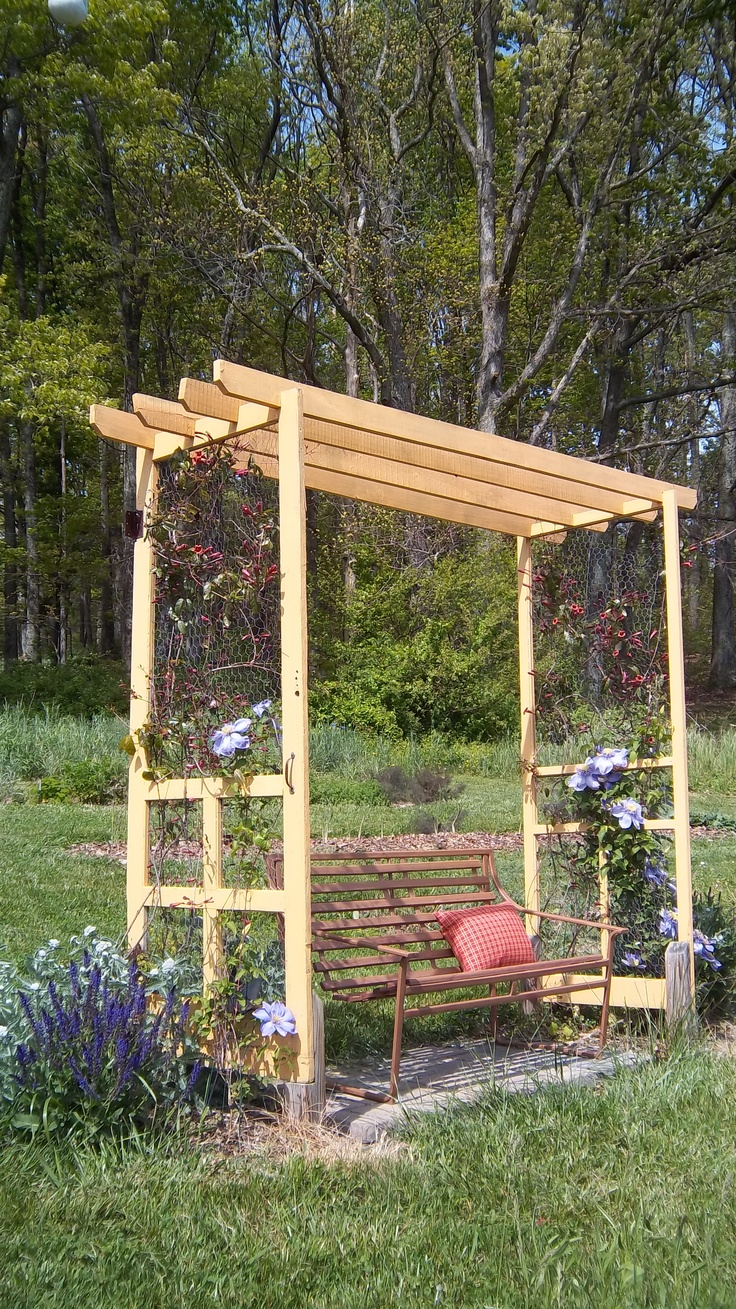Arbor from two old screen doors.  Chicken wire replaces old screen.