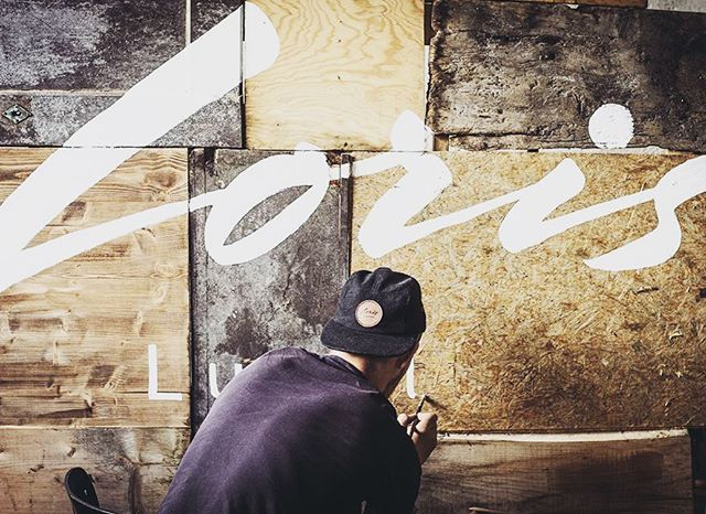 We produce as much as we can by ourselves in our atelier in Zürich. Here @aramis.navarro is working on a pannel we used for our launch party @visitorstore back in August       #lettering #garage #atelier #homemade #handmade #zürich #wood #pannel #swiss #sunglasses #lorislunettes #seeplaces