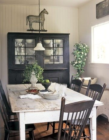 Great table and chairs and cabinet color play... neutral can swap paint and decor through the years/seasons